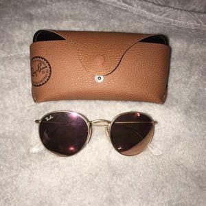 Rose Gold round Ray Ban sunglasses